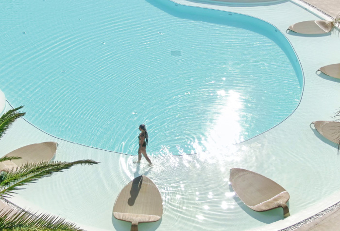 07-the-confetti-pool-with-the-leaf-loungers-for-tranquility-under-the-sun