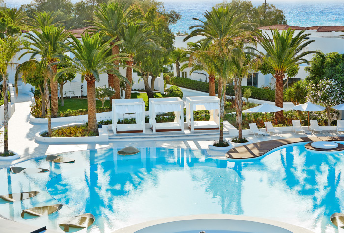 09-pool-lounges-and-relaxation-under-the-palm-trees-in-grecotel-caramel-boutique-resort